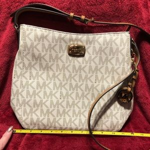 NWOT Authentic monogrammed MK crossbody bag.